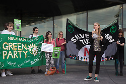London, UK. 5th June, 2021. Sian Berry, co-leader of the Green Party, addresses environmental activists and local residents protesting against the construction of the Silvertown Tunnel. Campaigners opposed to the controversial new £2bn road link across the River Thames from the Tidal Basin Roundabout in Silvertown to Greenwich Peninsula argue that it is incompatible with the UK's climate change commitments because it will attract more traffic and so also increased congestion and air pollution to the most polluted borough of London.