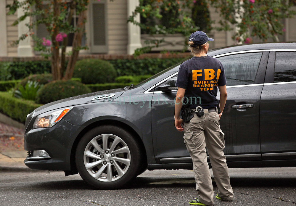 22 July 2016. New Orleans, Louisiana.<br /> A female FBI agent at a raid on a house on Coliseum and State street in Uptown New Orleans. FBI officials at the scene declined to comment on the nature of the raid.  <br /> Photo; Charlie Varley/varleypix.com