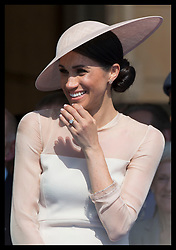 May 22, 2018 - London, London, United Kingdom - Image licensed to i-Images Picture Agency. 22/05/2018. London, United Kingdom. The  Duchess of Sussex laughs as her husband the Duke of Sussex gives a speech during  the Prince of Wales' 70th Birthday Patronage Celebration in the gardens of  Buckingham Palace in London. (Credit Image: © Stephen Lock/i-Images via ZUMA Press)