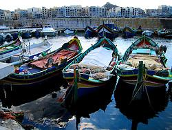 MALTA GOZO MARSALFORN 19JUL06 - Traditional Luzzu boats in Marsalforn fishing harbour...jre/Photo by Jiri Rezac..© Jiri Rezac 2006..Contact: +44 (0) 7050 110 417.Mobile:  +44 (0) 7801 337 683.Office:  +44 (0) 20 8968 9635..Email:   jiri@jirirezac.com.Web:    www.jirirezac.com