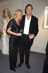 LORD BROCKETT and his fiance HARRIET WARREN at a private view of fashion designer Lindka Cierach's Couture Dresses drawn by Trudy Good held at the Belgravia Gallery, 45 Albemarle Street, London on 21st September 2005.<br /><br />NON EXCLUSIVE - WORLD RIGHTS