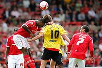 Photo: Steve Bond/Richard Lane Photography.<br />Nottingham Forest v Watford. Coca-Cola Football League Championship. 23/08/2008. Wes Morgan  (L) goes inwith a powerful headed challange on Grzegorz Rasiak (C)