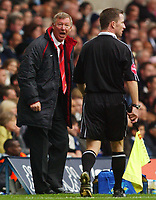 Photo. Daniel Hambury.<br />The Barclays Premiership.<br />Tottenham Hotspur V Manchester United. 25/09/2004.<br />Manchester United's manager Sir Alex Furguson has a word with the linesman