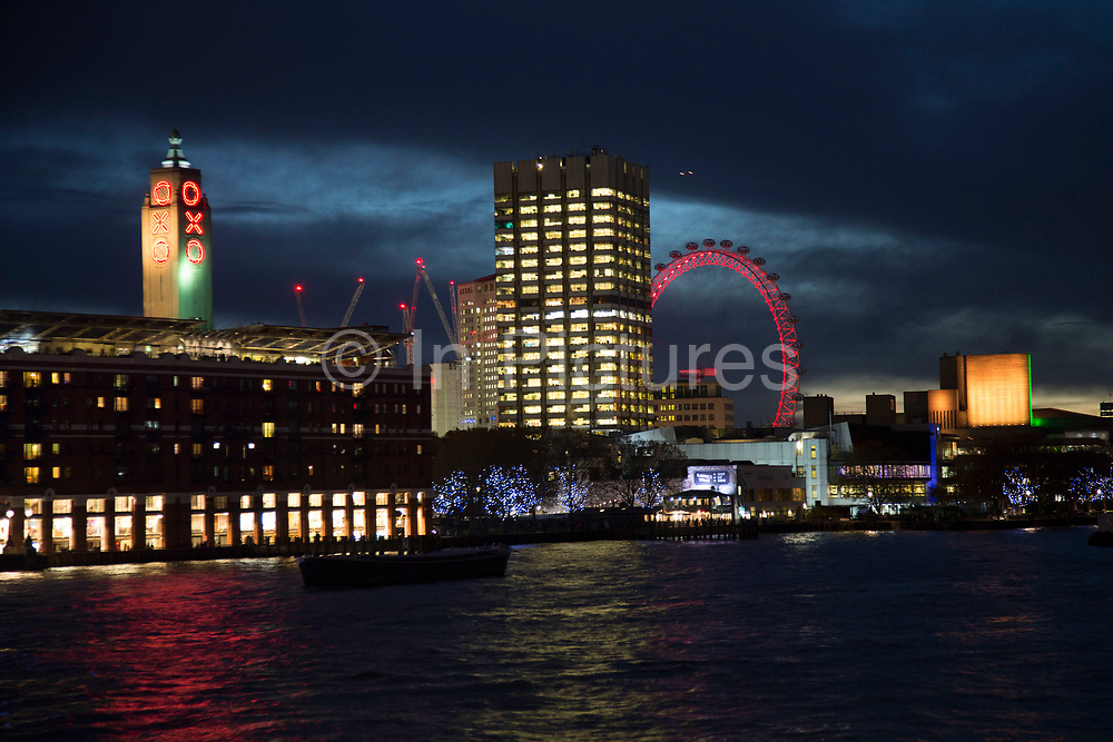 Night view across the River Thames towards the Oxo Tower, the National Theatre and the London Eye on the Southbank, London, United Kingdom. The South Bank is a significant arts and entertainment district, and home to an endless list of activities for Londoners, visitors and tourists alike.