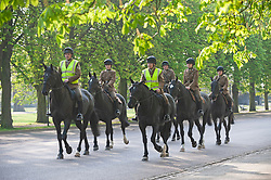 ©Licensed to London News Pictures 08/04/2020  <br /> Greenwich, UK. Soldiers on horseback riding through the park. People get out of the house from Coronavirus lockdown to exercise and enjoy the sunny weather in Greenwich park,Greenwich, London. Photo credit:Grant Falvey/LNP