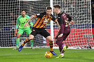 Swansea City midfielder Barrie McKay (19) is closed down by Hull City defender Ondrej Mazuch (3)  during the EFL Sky Bet Championship match between Hull City and Swansea City at the KCOM Stadium, Kingston upon Hull, England on 22 December 2018.