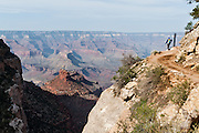 Hike Bright Angel Trail 9 miles round trip to Indian Garden in Grand Canyon National Park, Arizona, USA. Grand Canyon began forming at least 5 to 17 million years ago and now exposes a geologic wonder, a column of well-defined rock layers dating back nearly two billion years at the base. While the Colorado Plateau was uplifted by tectonic forces, the Colorado River and tributaries carved Grand Canyon over a mile deep (6000 feet / 1800 meters), 277 miles (446 km) long and up to 18 miles (29 km) wide.