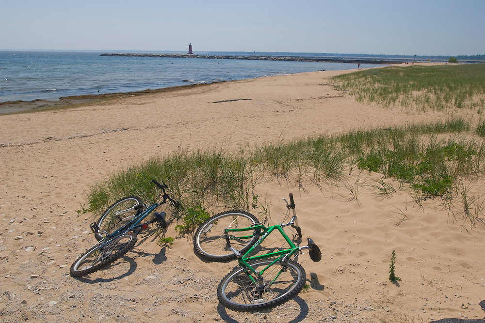 Bikes on a sandy Lake Michigan beach in Manistique Michigan.