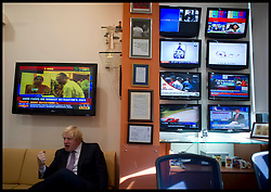 London mayor Boris Johnson talks to India's equivalent of David Letterman, Arnab Goswami. Goswami one of India's most prominent chat show hosts in his office as he appears on one of the country's most famous current affairs programmes, as part of a week long tour of India where he is trying to persuade Indian businesses to invest in London, Friday November 30, 2012. Photo by Andrew Parsons / i-Images