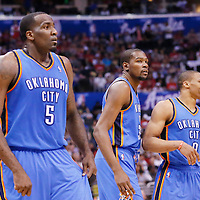 11 May 2014: Oklahoma City Thunder center Kendrick Perkins (5) is seen next to Oklahoma City Thunder forward Kevin Durant (35) and Oklahoma City Thunder guard Russell Westbrook (0) during the Los Angeles Clippers 101-99 victory over the Oklahoma City Thunder, during Game Four of the Western Conference Semifinals of the NBA Playoffs, at the Staples Center, Los Angeles, California, USA.