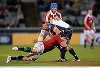 18 June 2013; Scott Sio, Brumbies, is tackled by Sean O'Brien and Justin Tipuric, British & Irish Lions. British & Irish Lions Tour 2013, Brumbies v British & Irish Lions, Canberra Stadium, Bruce, Canberra, Australia. Picture credit: Stephen McCarthy / SPORTSFILE