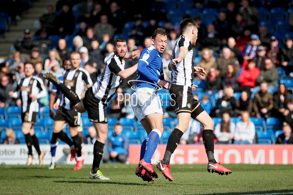 Chesterfield forward Kristian Dennis (9) with a glancing header that just went wide  during the EFL Sky Bet League 2 match between Chesterfield and Notts County at the Proact stadium, Chesterfield, England on 25 March 2018. Picture by Nigel Cole.