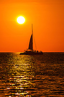Catamaran at sunset cruise off Key West, Florida Keys, Florida USA