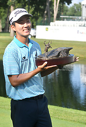 July 15, 2018 - Silvis, Illinois, U.S. - SILVIS, IL - JULY 15:  Michael Kim after winning  the John Deere Classic on July 15, 2018, at TPC Deere Run, Silvis, IL.  (Photo by Keith Gillett/Icon Sportswire) (Credit Image: © Keith Gillett/Icon SMI via ZUMA Press)