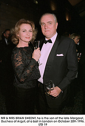 MR & MRS BRIAN SWEENY, he is the son of the late Margaret, Duchess of Argyll, at a ball in London on October 30th 1996.LTD 19