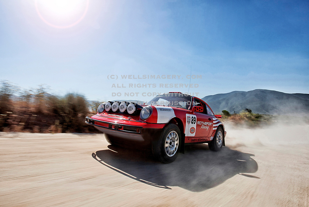 """Image of the """"Red Sled"""" Porsche 964 competing in the 2017 NORRA Mexican 1000 Rally with the Rothsport Racing Team in Baja, by Randy Wells"""