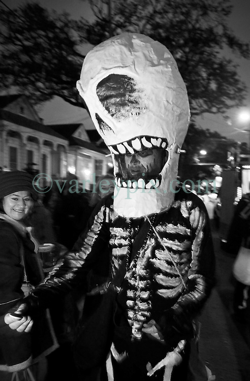 28 Feb 2014. New Orleans, Louisiana.<br /> Mardi Gras. Bud with the Skeleton Krewe as they prepare to walk the route for The Krewe D'Etat parade along Magazine Street through Uptown New orleans. <br /> Photo; Charlie Varley/varleypix.com