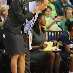 Notre Dame Fighting Irish head coach Muffet McGraw applauds her players during second half NCAA Big East women's basketball action between Notre Dame and Rutgers at the Louis Brown Athletic Center. Notre Dame defeated Rutgers 71-41.