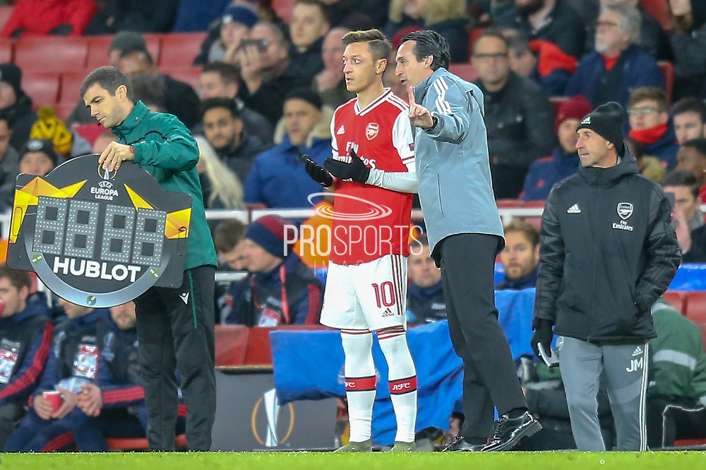Arsenal midfielder Mesut Özil (10) about to come on as a substitute during the Europa League match between Arsenal and Eintracht Frankfurt at the Emirates Stadium, London, England on 28 November 2019.