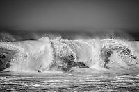 Winter waves along California's Big Sur coast crash into the shore.