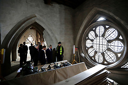 The Prince of Wales (second right) is shown works taking place during his visit to the The Queen's Diamond Jubilee Galleries at Westminster Abbey in London.
