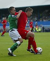 Photo: Andrew Unwin.<br />Northern Ireland v Wales. World Cup Qualifier.<br />08/10/2005.<br />Wales' David Partidge (R) holds off Northern Ireland's David Healy (L).