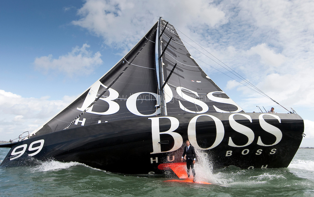 """Pictures of Alex Thomson (GBR) standing on the keel of his IMOCA Open 60 """"Hugo Boss"""". Solent UK..Credit all pictures:Lloyd Images...."""
