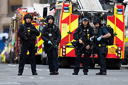 © Licensed to London News Pictures. 29/11/2019. London, UK. Armed Police are seen near Cannon Street Station following a terrorist incident on London Bridge.  Photo credit: George Cracknell Wright/LNP