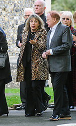 © Licensed to London News Pictures. 07/10/2014London, UK. Suzi Quatro arriving with Mike Batt for the funeral of singer Lynsey de Paul in Hendon, North London Photo credit : Simon Jacobs/LNP