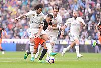 Real Madrid's Marcelo and Sergio Ramos and Valencia CF's Munir El Haddadi during La Liga match between Real Madrid and Valencia CF at Santiago Bernabeu Stadium in Madrid, April 29, 2017. Spain.<br /> (ALTERPHOTOS/BorjaB.Hojas)
