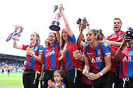 Crystal Palace FC ladies players  lifting the FA Premier League South East Division 1 and the Surrey Cup during the  half time break. Barclays Premier League match, Crystal Palace v Stoke City at Selhurst Park in London on Saturday 7th May 2016. pic by John Patrick Fletcher, Andrew Orchard sports photography.