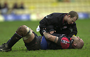 Watford, GREAT BRITAIN, 3rd April 2004, Vicarage Road, ENGLAND. [Mandatory Credit: Photo  Peter Spurrier/Intersport Images],<br /> 03/04/2004  - 2003/04 Zurich Premiership - Saracens v Gloucester<br /> Saracen's capt Simon Raiwalui, is tended by the physio.