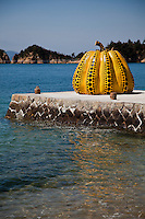 The bright yellow pumpkin covered with a pattern of black dots stands about two meters high. Created by Kusama Yayoi in 1994 it has  served as a symbol of the entire Naoshima art project and over time it has been joined by other pieces integrated with Naoshima's landscape. EDITORIAL USAGE ONLY - LICENSING OUTSIDE JAPAN ONLY