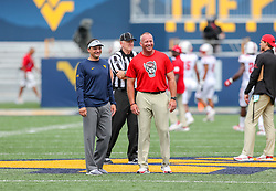 Sep 14, 2019; Morgantown, WV, USA; West Virginia Mountaineers head coach Neal Brown and North Carolina State Wolfpack head coach Dave Doeren talk before the game at Mountaineer Field at Milan Puskar Stadium. Mandatory Credit: Ben Queen-USA TODAY Sports