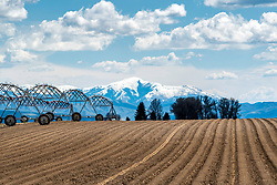 A plowed field and irrigation system in Shelly Idaho