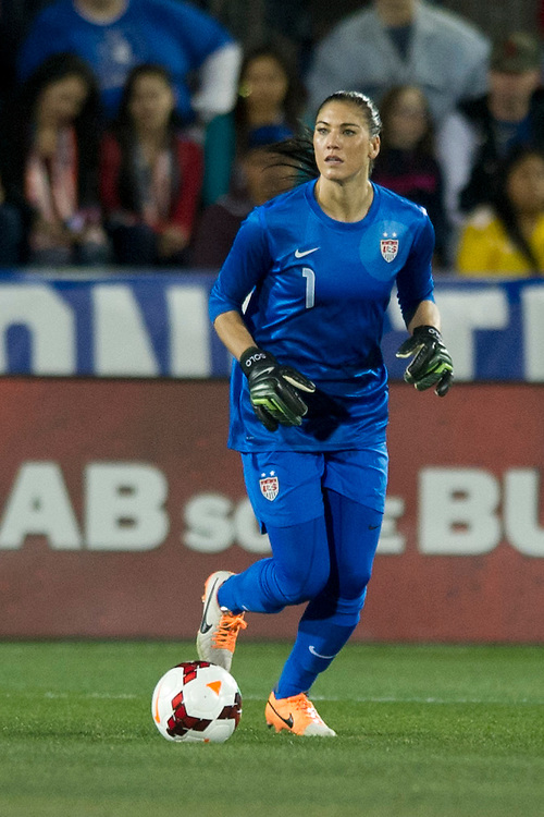 FRISCO, TX - JANUARY 31:  Hope Solo #1 of the U.S. Women's National Team controls the ball against the Canadian Women's National Team on January 31, 2014 at Toyota Stadium in Frisco, Texas.  (Photo by Cooper Neill/Getty Images) *** Local Caption *** Hope Solo