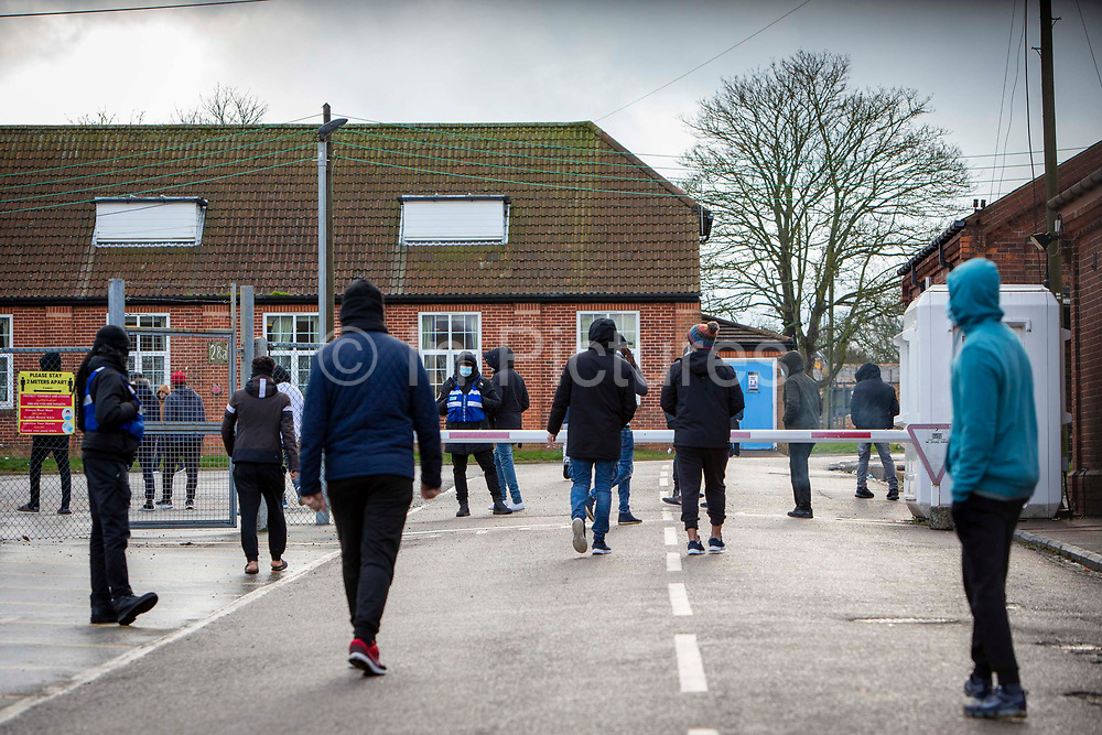 Asylum seekers held inside Napier Barracks head to a meeting with Home Office representatives after staging a peaceful protest outside the entrance to the barracks with banners and signs to demonstrate about the poor conditions they are subjected to inside the holding centre on the 12th of January 2021, Folkestone, United Kingdom. Over 400 asylum seekers are being kept at Napier Barracks in unsuitable, cold accommodation, they are experiencing mental health issues including several suicide attempts as well as being vulnerable to health conditions including COVID-19.