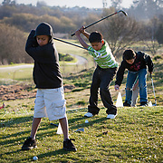 The First Tee of Monterey County opens the door to golf, as well as academic tutoring,  to many underprivileged kids of Salinas, CA, like Jose Calderon, center, on backswing.