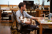 Dogs are a part of the culture at Swift, a digital ad agency  housed in a refurbished former Wells Fargo garage in Northwest Portland. Ava sits with Rich Barnes.  Randy L. Rasmussen/Staff
