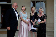 SIR CHARLES LOWTHER; LADY LOWTHER; MRS. GRUFFUDD JONES; LADY BARTLETT, The Goodwood Ball. In aid of Gt. Ormond St. hospital. Goodwood House. 27 July 2011. <br /> <br />  , -DO NOT ARCHIVE-© Copyright Photograph by Dafydd Jones. 248 Clapham Rd. London SW9 0PZ. Tel 0207 820 0771. www.dafjones.com.