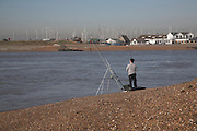 Man fishing, mouth River Deben Suffolk, England