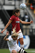 04 December 2011: Stanford's Alina Garciamendez (4) heads the ball over Duke's Kaitlyn Kerr (5). The Stanford University Cardinal defeated the Duke University Blue Devils 1-0 at KSU Soccer Stadium in Kennesaw, Georgia in the NCAA Division I Women's Soccer College Cup Final.