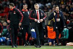 Manchester United interim manager Ole Gunnar Solskjaer (centre) walks on after half time during the Premier League match at Old Trafford, Manchester.