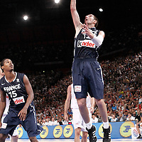 15 July 2012: Nando De Colo of Team France goes for the layup during a pre-Olympic exhibition game won 75-70 by Spain over France, at the Palais Omnisports de Paris Bercy, in Paris, France.