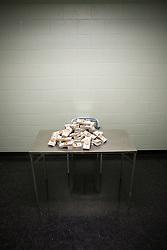Jul. 25, 2012 - Money on table in interview room (Credit Image: å© Image Source/ZUMAPRESS.com)