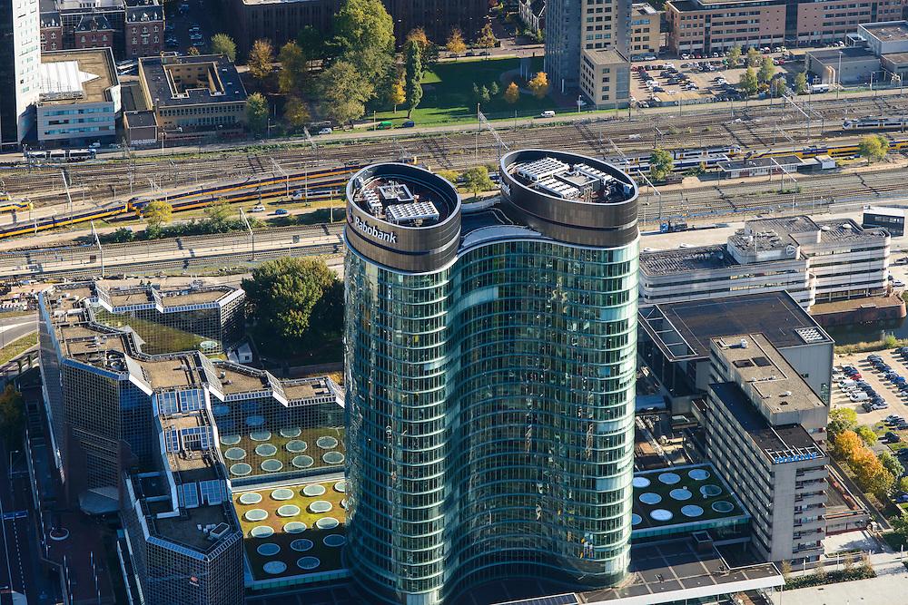 Nederland, Utrecht, Utrecht, 24-10-2013;<br /> Close-up hoofdkantoor van de RABO-bank, de dubbele toren van groen glas, de Rabotoren (architect:  Rob Ligtvoet van Kraaijvanger Urbis), bijnaam de verrekijker bij het Centraal Station en Hoog Catherijne.<br /> Close up headquarters of the Rabobank, the double tower of green glass, the Rabotoren (architect:  Rob Ligtvoet of Kraaijvanger Urbis), nicknamed the binoculars.  View on central station, shopping center Hoog Catharijne.<br /> luchtfoto (toeslag op standaard tarieven);<br /> aerial photo (additional fee required);<br /> copyright foto/photo Siebe Swart.