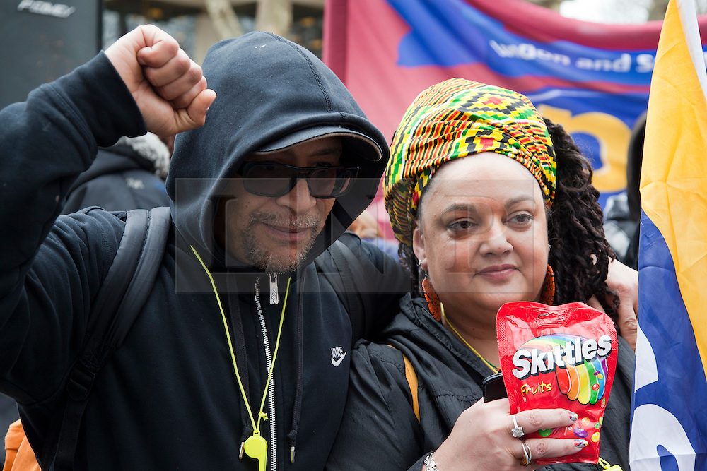 © Licensed to London News Pictures. 31/03/2012. London, England. Lee Jasper (left) and Zita Holbourne (right) of BARAC hold an empty bag of Skittle sweets as they protested outside the U.S. Embassy in Grosvenor Square, London against the shooting of black  youth Trayvon Martin by George Zimmermann in Sanford, Florida. Trayvon Martin was carrying an empty bag of Skittles when he died. Photo credit: Bettina Strenske/LNP