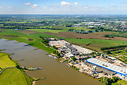 Nederland, Gelderland, Gemeente Lingewaard, 29-05-2019; Looveer, nabij Huissen, met steenfabriek en vernoemd naar de veerpont over de Neder-rijn naar het Loo en Westervoort.<br /> Looveer, near Huissen, with a brick factory and named after the ferry across the Lower Rhine.<br /> <br /> luchtfoto (toeslag op standard tarieven);<br /> aerial photo (additional fee required);<br /> copyright foto/photo Siebe Swart
