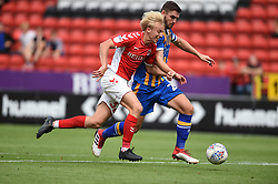 Charlton Athletic's George Lapslie (left) and Shrewsbury Town's Luke Waterfall battle for the ball