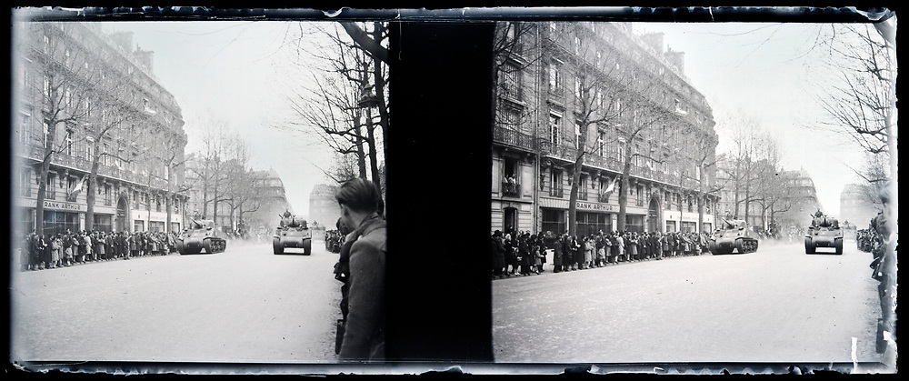 army tanks during a liberation parade France 1944 with people lining the street